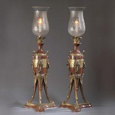Une belle paire de candélabres en bronze et marbre rouge de Campan par G. Servant. Chaque candelabre repose sur un support a trois pieds. France, vers 1880.[Ref : B65944]Pour plus d'informations et des photos supplémentaires consultez notre site internet : www.adrianalan.com