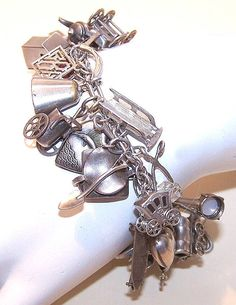 C.1940 STERLING SILVER Charm Bracelet with 36 Charms.....