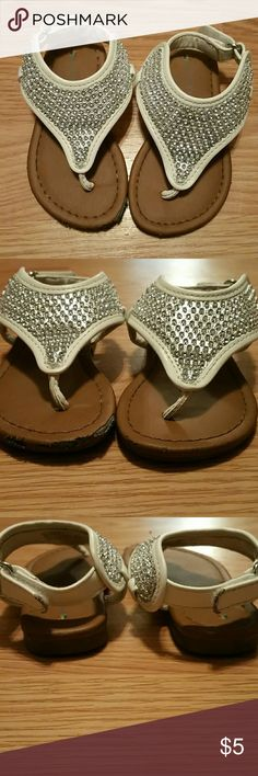 Sparkle Sandles Brown soles. The straps are white with a silver material and rhinestones. Velcro closure in the back. Small scuff on the big toe side of each shoe. Shoes Sandals & Flip Flops