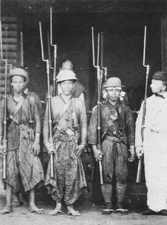 Samurai guards of the Dutch diplomatic mission in Nagasaki, shown with Western style rifles and attached bayonets, 1863.