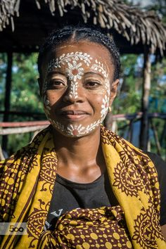 Malagasy woman of ethnicity Sakalava with traditional mask in Nosy Be island, North of Madagascar.