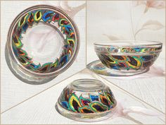 RichanaDragon     Dragon feathers. Glass bowl (candle holder) with bright and contrast rainbow colors stylized feathers (or petals) pattern. Hand painted stained glass.
