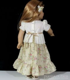 (Circa 1974) -- Back view. Tiered peasant skirt paired with pleated eyelet top