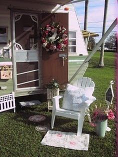 Love how the screen door on this camper has been decorated to look like a farm house screen door...do-able!