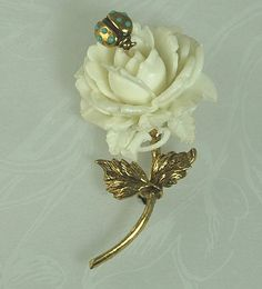 White Celluloid rose brooch with lady bug  Pauline Rader