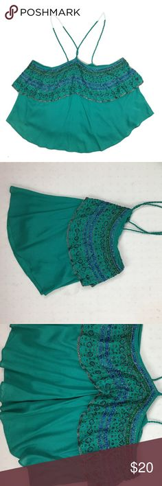 Free People turquoise hi-low top **** IF YOU THINK OUR AFFORDABLE PRICES ARE TOO HIGH FOR YOU, MAKE A REASONABLE OFFER ON ANY OF THE ITEMS IN OUR STORE AND WE MAY ACCEPT IT****     - Size: small  - Material:  - Condition: EXCELLENT, like new  - Color:  - Pockets: n/a  - Lined: n/a - Closure: button/ pullover - Pair with:    *Measurements:   Bust:  WAIST: Length:  SLEEVE: Rise: Inseam:   * The more you buy the more you save. Feel free to ask any questions. Thank you for stopping by. * tank…