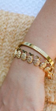 Every girl needs a gold pineapple bracelet in her life, and this engraved roman numeral bracelet from Taudrey is so special to me! It features my mother's birthday, so that I can always remember her!