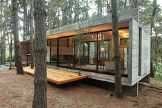 Simple modern forest escape..love the big open 'window' overlooking the forest.