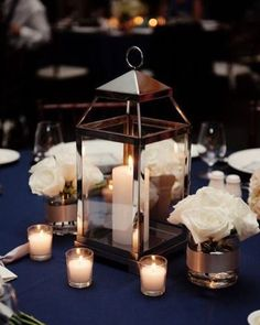Super budget saving tip! Skip large floral centerpieces for candle arrangements! Go with lanterns and pint size arrangements for a budget friendly additional touch!    Photography: Robert and Kathleen Photography