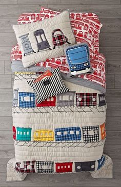 Shop All Aboard Train Bedding.  Our train kid bedding will get you on the right track to creating the perfect kids room, so hop aboard.  It includes a quilt and sham with appliqued and embroidered trains against grey striped backgrounds.