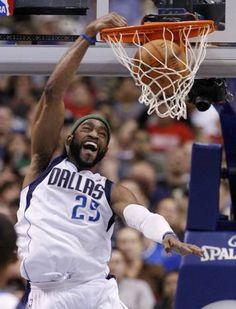 Dallas Mavericks' Vince Carter (25) dunks against the Sacramento Kings in the second half of an NBA basketball game Tuesday, April 10, 2012, in Dallas. The Mavericks won 110-100.