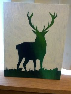 Needs another coat of white paint but its finished! Deer silhouette on canvas board.