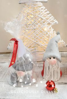 Scandinavian Nordic Christmas gnomes.  These have cake in their tummies, icing and ganache all over them.  They are great christmas gifts as they come packaged with a red ribbon and gift tag.  They make great teacher gifts, gifts for colleagues and grandparents and other family.  These are unique and individual chrsitmas gifts and can be tailored to requirements and come in a variety of flavours too. Available in sitting or standing sizes.