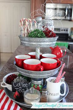 Such a cute way to use a 3-tiered galvanized stand. This would be great for other holidays too--like red/white/blue for 4th of July or Fall decorations. See this whole cute holiday home tour here.