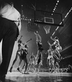 College basketball has been a cultural touch point for years. This epic action shot was captured in 1951 at a Bradley vs. St. John's at Madison Square Garden. (Photo: Gjon Mili—Time & Life Pictures/Getty Images)