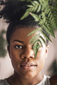 Artistic portraiture using leaves by Atlanta photographer Chanel G. Photography