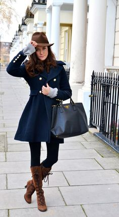 This is a great look - the cut of the coat is so flattering; her hat & boots make the whole look distinct!