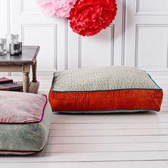 orange and blue velvet floor cushion from graham and green