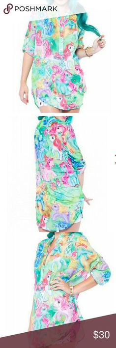 *COMING SOON* Iron Fist My Little Pony Blouse Arriving soon! Comment below to be notified when it comes in. Last of the stock. Won't be available again.  Front button closure. Front breast pocket. Mandarin collar. Relaxed fit. Button Sleeve tabs. My Little Pony licensed collaboration. This print is the hard to find, ORIGINAL MLP. Not the new cartoon-y looking ones. All the t-shirts and bags out now are graphics from the new MLP generation, but not this! Iron Fist Tops Blouses