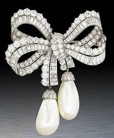 A rare diamond and natural pearl bow brooch, which features two exceptional large natural saltwater pearls suspended by diamond ribbons - Cartier. Bow Jewelry, Cartier Jewelry, High Jewelry, Pearl Jewelry, Antique Jewelry, Vintage Jewelry, Jewelry Accessories, Jewelry Design, Jewelry Stores