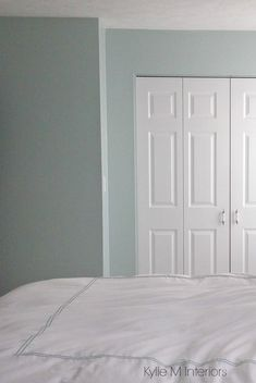 Sherwin Williams Rainwashed is a blue green gray blended paint colours. Shown in bedroom. Color consulting by Kylie M Interiors