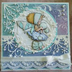 Lovely shading, the glitter and lace add such nice accents, the pearls on the die cut add extra wow! Beautiful!