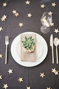 Minus the place setting, a black table cloth with some cheap shiny gold stars where food is.