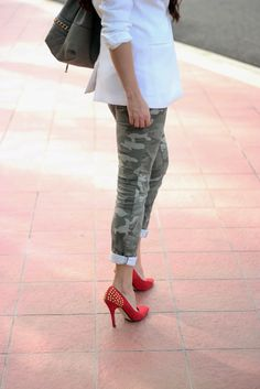 Camo pants and red studded pumps