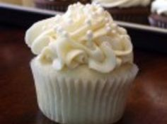 White Wedding Cake Cupcakes  Great recipe just wish it wasn't boxed cake