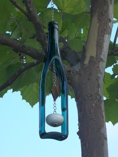 Teal Wine Bottle Wind Chime with brass chain and wooden knocker.