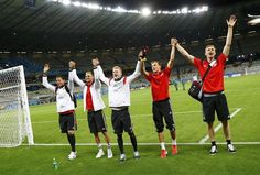 Germany's national soccer players celebrate after their 2014 World Cup semi-finals against Brazil at the Mineirao stadium in Belo Horizonte (L-R) Germany's national soccer players Roman Weidenfeller, Shkodran Mustafi, Andre Schuerrle , Kevin Grosskreutz and Per Mertesacker celebrate after their 2014 World Cup semi-finals against Brazil at the Mineirao stadium in Belo Horizonte July 8, 2014. REUTERS/Kai Pfaffenbach (BRAZIL - Tags: SOCCER SPORT WORLD CUP)