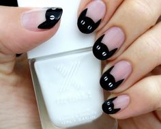 Cute and charming black cat Halloween nail art. Draw on cute black cats as your French tips for this Halloween.