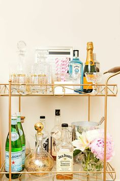 Thrifted Gold Barcart with Vintage Crystal Decanters | Tiffany Leigh's Toronto Studio Tour | The Everygirl
