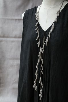 Inspired by the subtle tendrils of a vine, this lariat-style necklace is composed of delicate crochet spirals that drape beautifully. Offered in 4 neutral shades, the tendril adds a touch of bohemian Textile Jewelry, Fabric Jewelry, Beaded Jewelry, Handmade Jewelry, Crochet Motifs, Knit Crochet, Lariat Necklace, Crochet Accessories, Beautiful Crochet