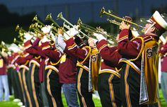 Photo By Robert J. LucasTrumpet players in the Stow-Munroe Falls High School marching band perform during a half-time show earlier this season