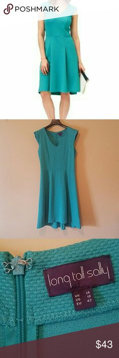 """Flirty Skater Dress Fun and flirty Long Tall Sally Skater dress, size 10US. Perfect for taller women looking for a knee length-will be slightly longer than the knee for those under 5'8"""" or so. Beautiful turquoise color, small cap sleeves, V- neck, zipper & clasp back, flattering seaming on the bodice, sits at natural waist with a flowy skirt- extremely flattering on all body types! 41 1/2 inches from top middle to back of skirt, front is a couple inches shorter. Perfect dress for work, date…"""