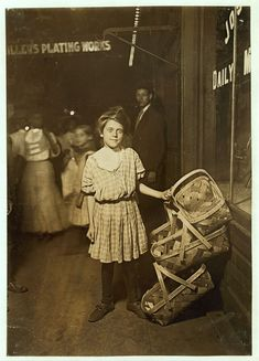 "Nearly Sold Out! ""Basket ! Five Cents Each!"" Antoinette Siminger, 12 years old, 4219 Glenway Ave., Price Hill, Sixth St., Market, Cincinnati. 10 P.M. Had been selling since morning. Location: Cincinnati, Ohio Aug. 1908"