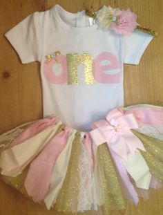 Light Pink, Ivory, and Gold 1st Birthday Scrap Fabric Tutu Outfit by ScrapHappyTutus on Etsy https://www.etsy.com/listing/208739172/light-pink-ivory-and-gold-1st-birthday