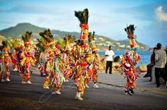 Cultural dancers in St Kitts entertain by the waters edge.