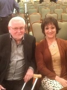 Walt Hippauf and wife Marci, of Help-U-Sell Peoples Real Estate, waiting for the Dan Desmond-Scott Einbinder debate