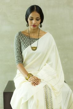 Plain white saree with black printed blouse