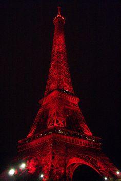 Eiffel Tower in red by Caroline, Kelly, Connor & Jesse, via Flickr