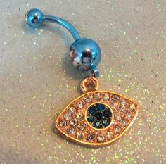 #YOUniqueDZignsArtfire on Artfire                   #ring                     #Belly #button #ring #rose #gold #evil #blue #zircon #crystals                Belly button ring w rose gold evil eye and blue zircon crystals 14 ga                                   http://www.seapai.com/product.aspx?PID=680776