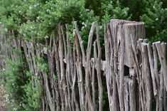 A stick fence idea to use the brush from my new garden area. think i will take down the fence and build this. sorry michael :/