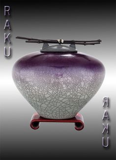 Cremation Urn for ashes Raku Ceramic by doderostudioceramics, $275.00  Although pricey an idea for your two incumbants.