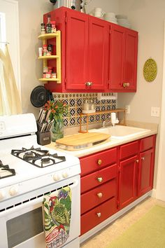 Great idea for a spice rack connected to the end of kitchen cabinets. ****LOVE the red cabinets*** Stained Kitchen Cabinets, Red Cabinets, Small Kitchen Cabinets, Small Kitchen Storage, Farmhouse Kitchen Cabinets, Kitchen Cabinet Design, Kitchen Decor, Kitchen Ideas, Extra Storage