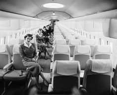 3/21/1956-New York, NY: Mockup of tomorrrow's jet comfort: Gracing the luxurious mockup of the Boeing Jet Stratoliner, which will enter service with airlines of the world in 1959, are a group of airline stewardesses. The half-million dollar mockup is the first such jet transport interior to be completed in America and was unveiled on the eigth floor of a Manhattan building. It seats 98 passengers, has airconditioning, lighting system, running water, ovens, and refrigerators. Each seat has…