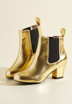 Lover of Luster Bootie in Gold. Given your penchant for polish and shine, of course you believe these ankle boots offer the perfect amount of edgy aesthetic! #gold #modcloth