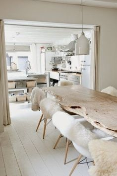 All white kitchen and dining. The sheepskin chair covers are a warm and inviting decor idea. Home Decor Salle à manger Dining Room Inspiration, Interior Inspiration, Scandinavian Style, Scandinavian Interiors, Scandi Style, Dining Area, Dining Rooms, Dining Tables, Home And Living