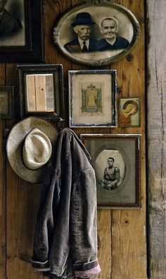 vintage picture vignette - so quaint...she has a wood palette wall tutorial that I'd love to do right over old wallpaper in our entry way